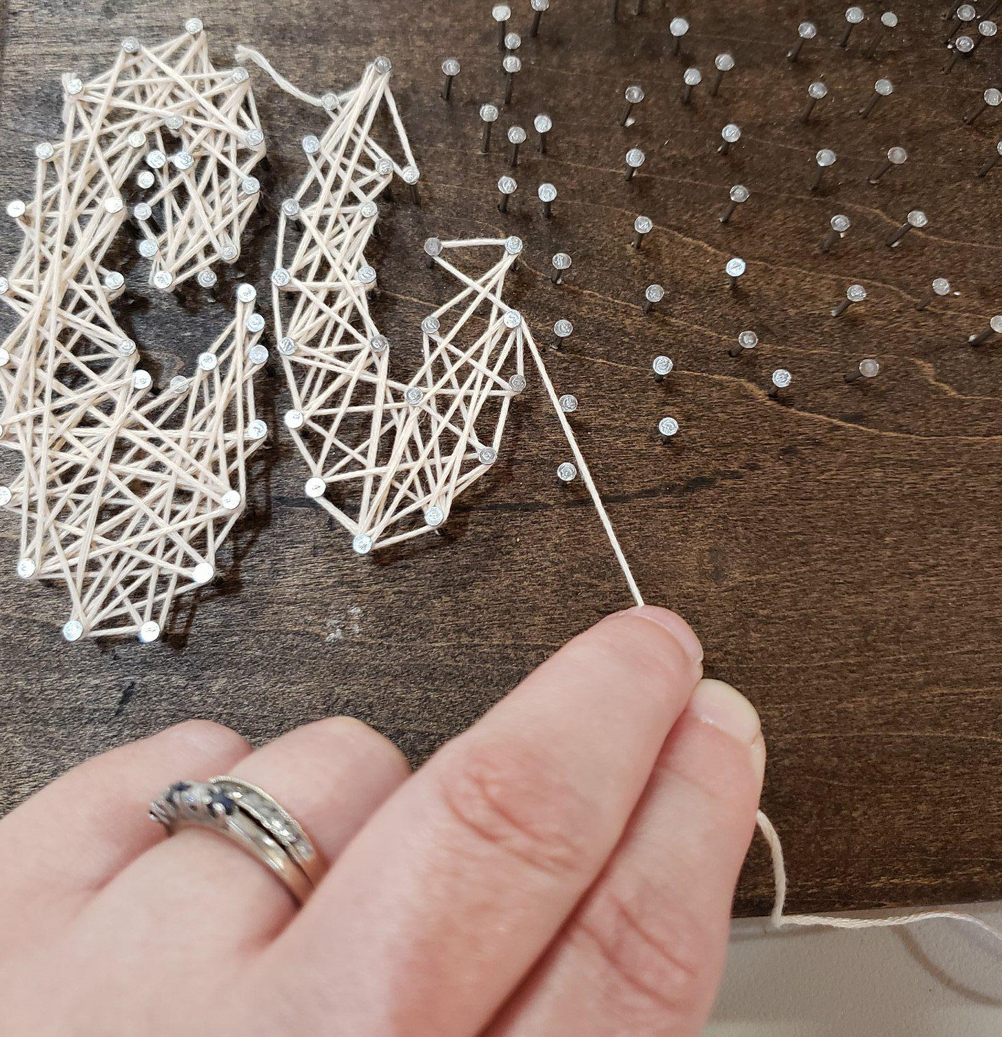 wrapping string around the nails